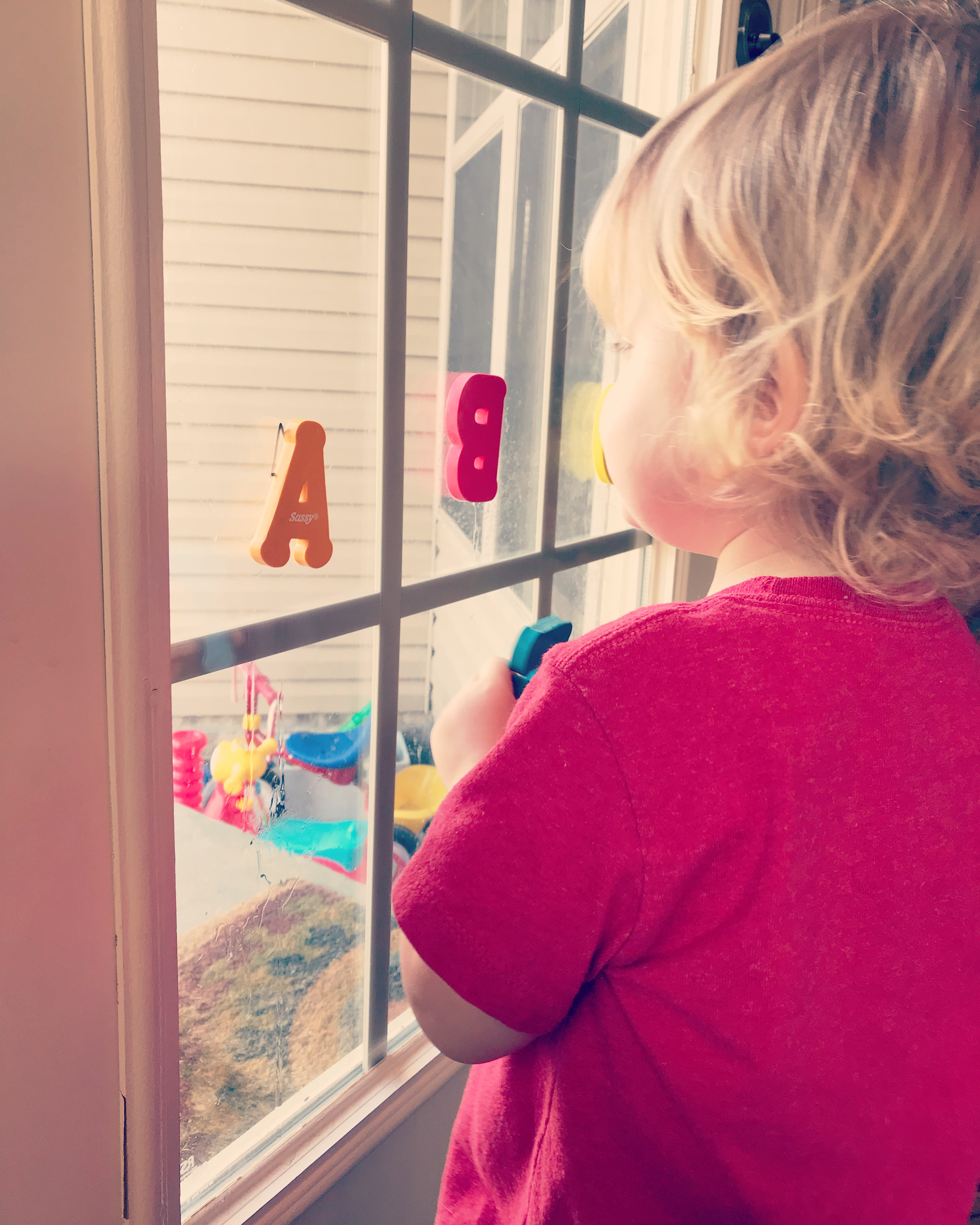 We use foam letters and stick them to the window for some toddler fun!